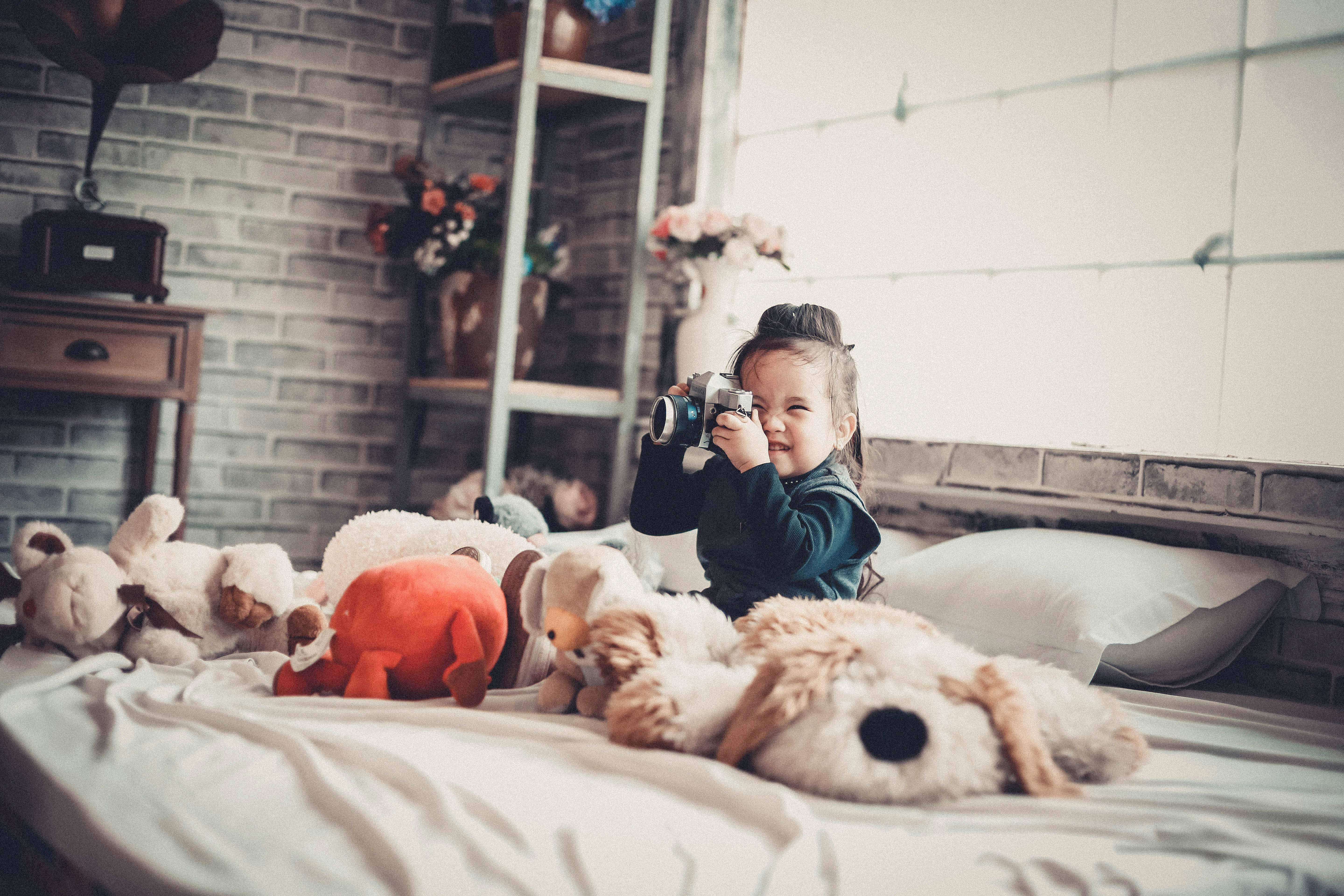 Child play with camera, pillow, joy, toys, play