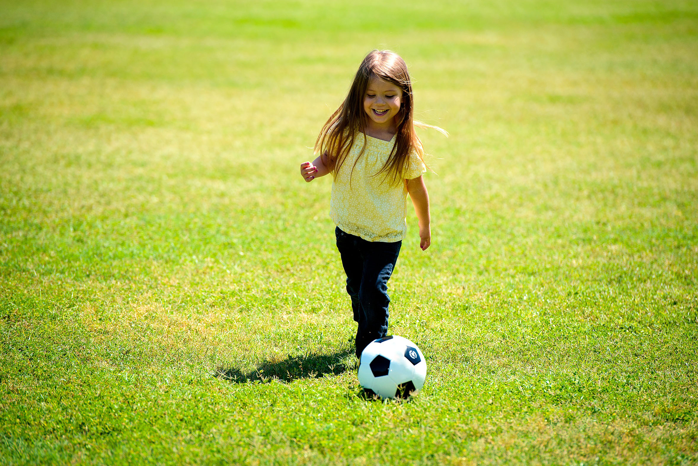 Cute young girl playing soccer picture women over movies