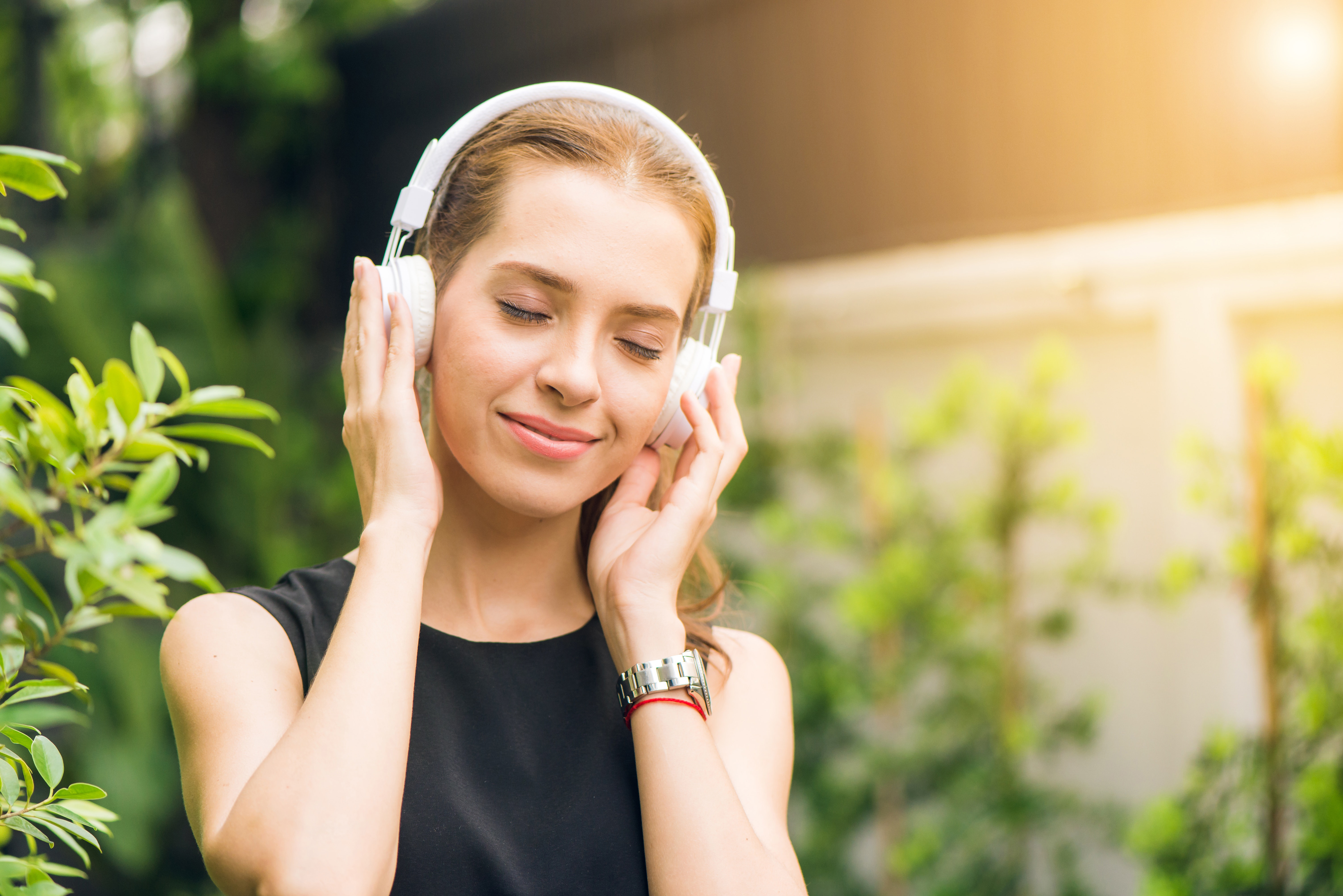 Listening music,smiling,sound,woman,young
