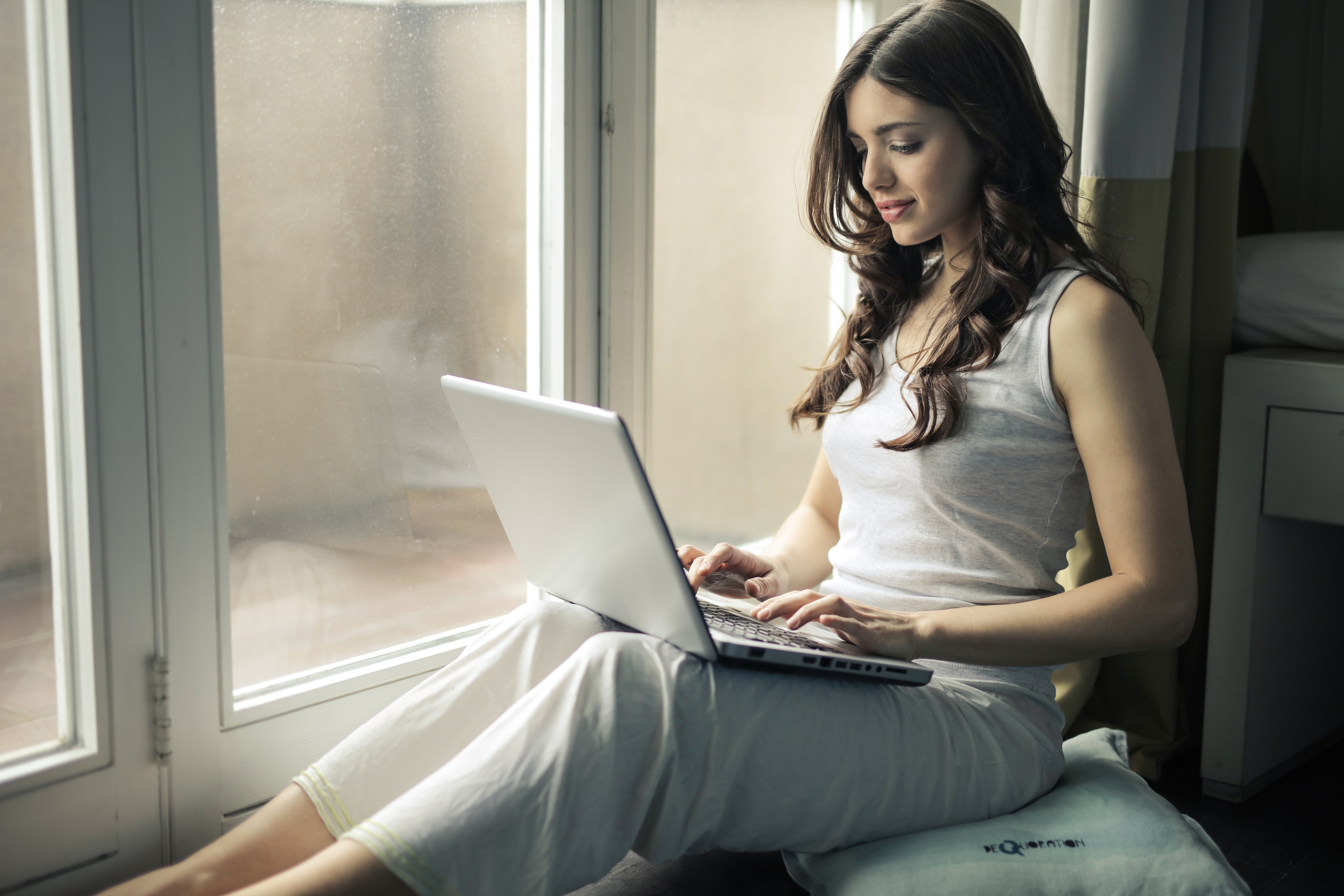 Woman Sitting by the Window adult